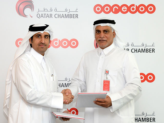 Ooredoo and Qatar Chamber sign 2 [qatarisbooming.com].jpg