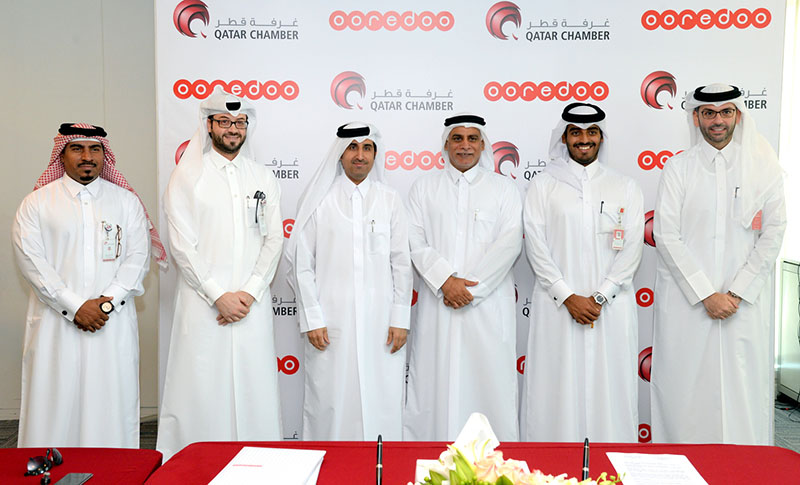 Ooredoo and Qatar Chamber sign 3 [qatarisbooming.com].jpg