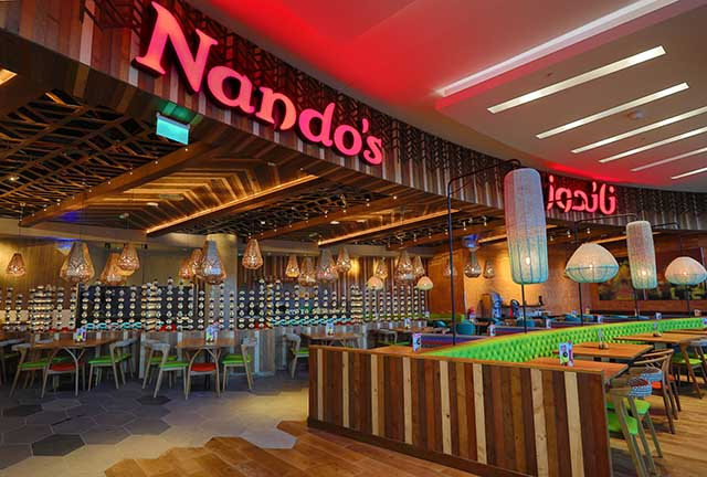 Nando's celebrates being first 2 [qatarisbooming.com].jpg